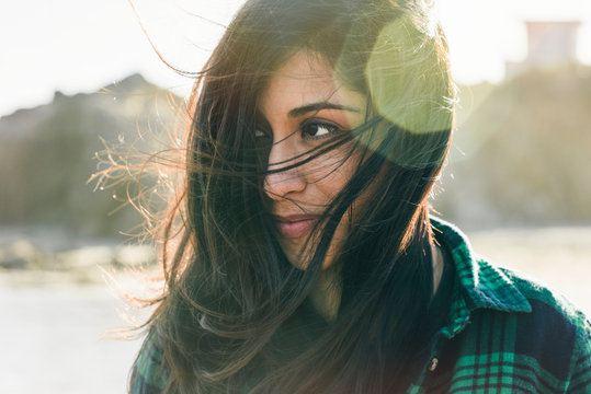 Close up of young woman with tousled hair