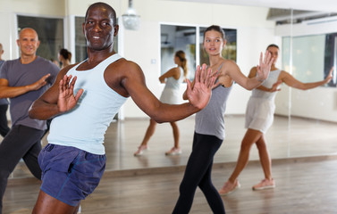 Multinational young people dancing together in modern studio