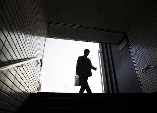 Low angle view of businessman entering in subway station