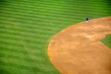 High angle view of man walking on baseball field