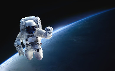 Foto auf AluDibond Nasa Astronaut in the outer space over the planet Earth. Abstract wallpaper. Spaceman. Black bakground. Elements of this image furnished by NASA