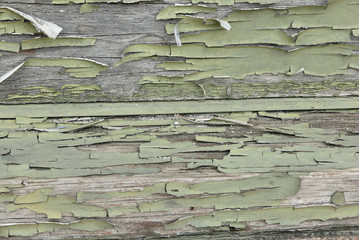Wood with flaking pale green paint