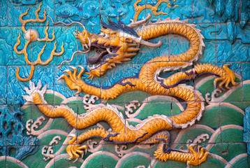 Close up of traditional Chinese dragon on tiles