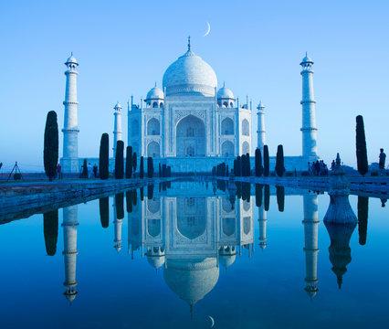 Exterior view of Taj Mahal reflecting in water