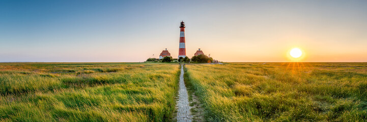 Spoed Fotobehang Beige Panorama of the Westerheversand Lighthouse at Westerhever in Nordfriesland in the German state of Schleswig-Holstein