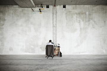 Businessman using desktop computer in office space