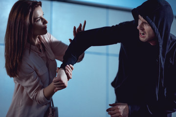 beautiful woman fighting with thief in underpass