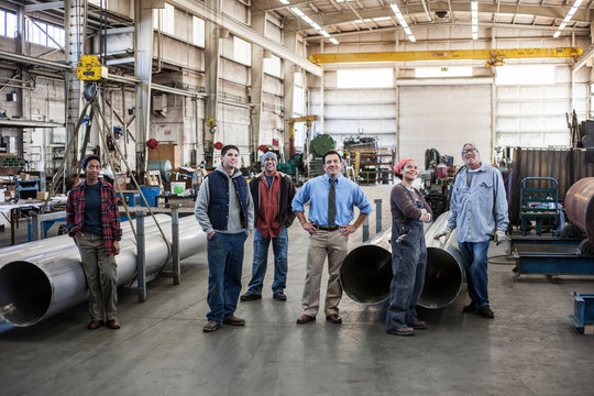 Workers standing in factory