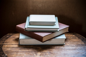 Close up of stack of books on wooden table