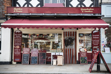 Exterior view of butcher shop with blackboards