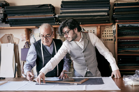 Tailors working together in workshop