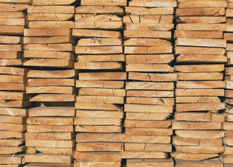 Close up of stack of cut lumber