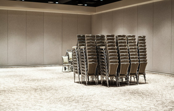 Chairs stacked in empty meeting room