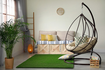 Stylish modern room interior with swing chair