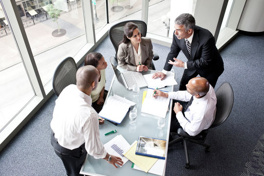 High angle view of business people talking during office meeting