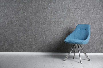Blue modern chair for interior design on wooden floor at gray wall Wall mural