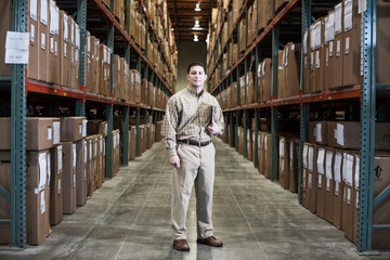 Portrait of manager standing in warehouse