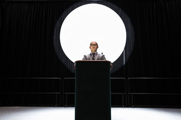 Businessman giving speech at convention center
