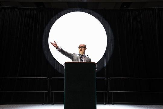 Businessman giving speech at convention center