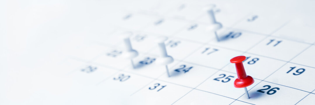 Tacks On Calendar Page/Business Concept