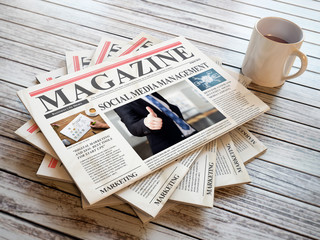 Newspapers with marketing articles on wooden background