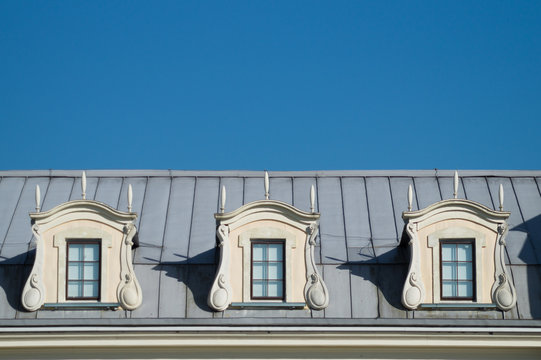 Roof with windows. attic of the house with the sky