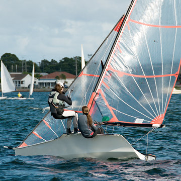 Children Sailing small boats and dinghies on salt water.