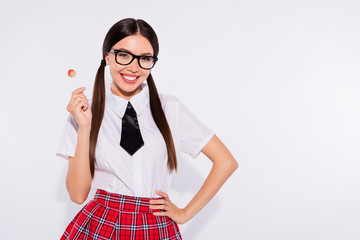 Portrait of her she nice-looking attractive lovely charming cute cheerful cheery girl wearing eyeglasses eyewear licking sugary sweets confectionery isolated over light white background