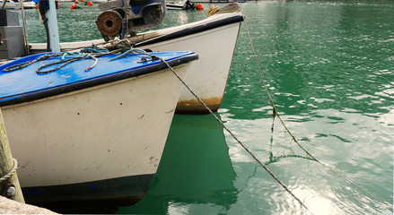 High tide at the harbour, with moored boats and glossy water