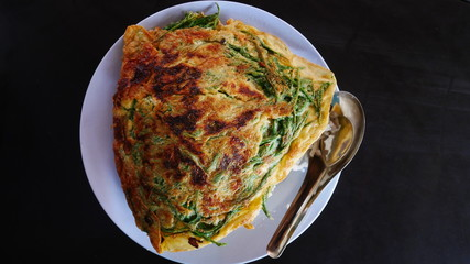 omelet with mushrooms and vegetable Asian food Myanmar style