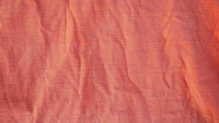 texture of red fabric background, orange cotton cloth texture