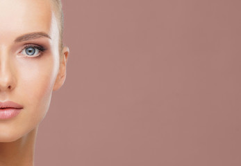 Beauty portrait of healthy and attractive woman. Human face in a concept of spa, skin care, cosmetics, make-up, complexion and face lifting.