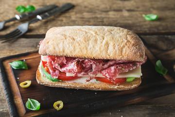 Photo sur Aluminium Snack Big italian sandwich. Salami sandwich