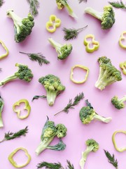 Fototapete - creative flat layout of vegetables top view, broccoli on a pink background