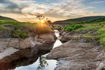 Fototapete - Sunset at Pont Ar Elan in the Elan Valley