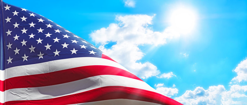 usa american flag isolated on blue cloud sky background panorama wide view of natural color of united states of america national symbol waving sign for patriotic day landscape photo wallpaper