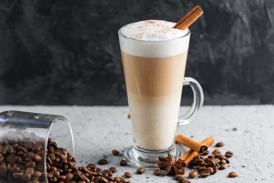 Coffee latte in a glass on a concrete table