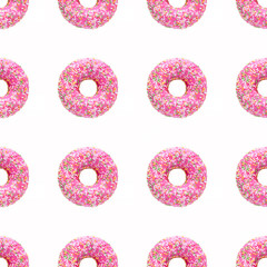 Seamless pattern made of smooth even round pink donuts with icing glaze and  bright sugar green, red, white and yellow colored vermicelli sprinkle topping. Isolated objects overhead view.
