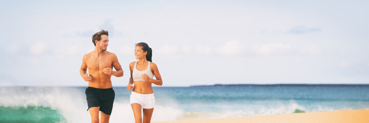 Sport athletes runners couple running training cardio on beach panoramic banner background . Summer active lifestyle.