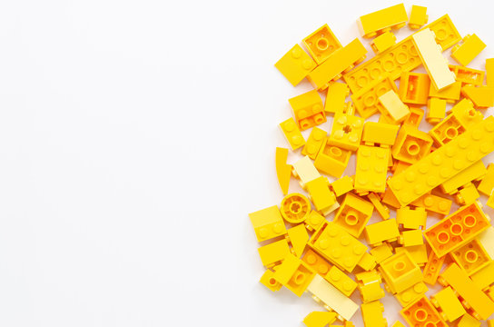 Yellow Educational Toys Bricks Blocks Top View isolated on White Background