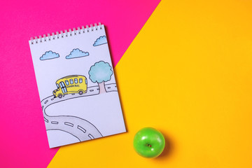 notebook with a picture of a school bus