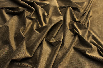 The texture of the cotton fabric is velveteen beige. Background, pattern.