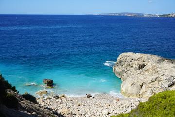 Wild rocky laguna beach in Palma de Mallorca, Spain