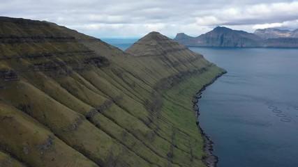 Wall Mural - Flight over mountains on Faroe Islands