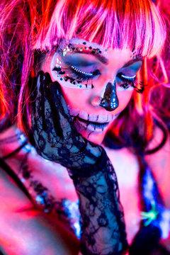 Woman with fluor sugar skull makeup