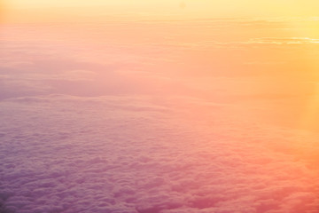 Above the clouds with a beautiful golden light during sunrise