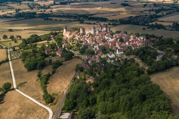 Village and castle of burgundy in France. View from above by a drone
