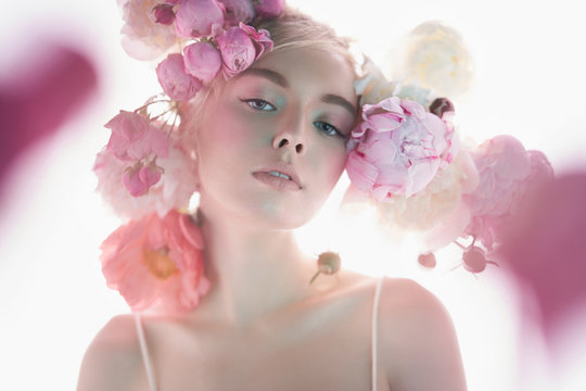 Young beautiful woman with bouquet of roses. Professional art makeup.
