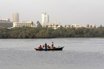 Fishermen head back after a day catch near the port area in Karachi