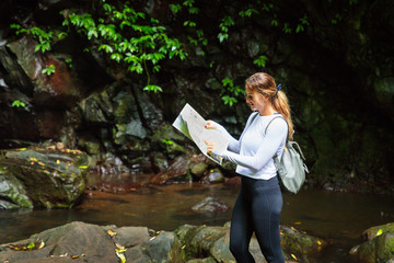 Woman reading map in Australian rainforest, Lamington National Park